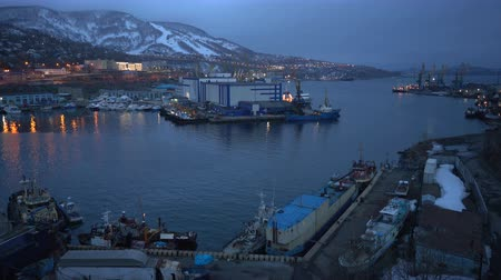 night scape : PETROPAVLOVSK CITY, KAMCHATKA PENINSULA, RUSSIAN FAR EAST - 14 MAY, 2018: Evening view of Petropavlovsk-Kamchatsky City and fishing boat at the Pacific Ocean. Stock Footage