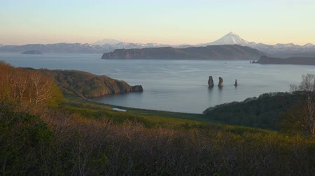 port n : Pacific Coast of Kamchatka Peninsula: stunning summer evening view of seascape, rocky mountains and volcanoes on shores of Avacha Bay on sunny weather. Kamchatka Region, Russian Far East, Eurasia. Stock Footage