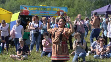 ethnographic : KAMCHATKA PENINSULA, RUSSIAN FAR EAST - 25 AUGUST, 2018: Young woman in a national dress, aboriginal of Kamchatka performs expression traditional dance called The Seagull. Stock Footage