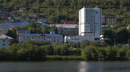 petropavlovsk : PETROPAVLOVSK CITY, KAMCHATKA PENINSULA, RUSSIA - SEP 10, 2018: Multi-story office building of Okeanrybflot - largest fishing enterprises of Kamchatka Region, building of Fire Station on lake shore. Stock Footage
