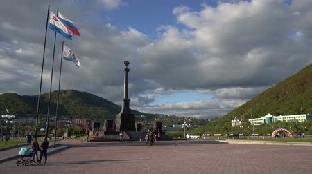 memorial day : PETROPAVLOVSK KAMCHATSKY CITY, KAMCHATKA PENINSULA, RUSSIA - SEP 10, 2018: Stela City of Military Glory on Petropavlovsk-Kamchatsky, people walking around square in front of monument. Time lapse.