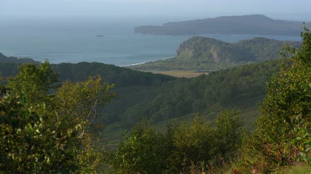 petropavlovsk : Beautiful autumn Pacific Coast seascape, mountain shore overgrown with forest. Russian Far East, Kamchatka Peninsula, Avacha Gulf, neighborhood of Petropavlovsk-Kamchatsky City.
