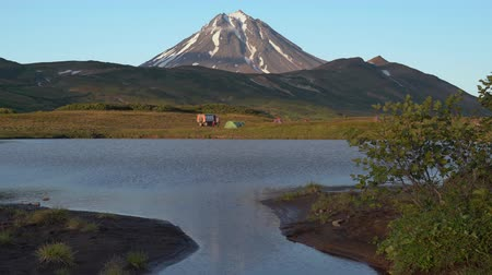 vacations cones : Stunning evening autumn landscape of Kamchatka Peninsula at sunset: alpine lake.