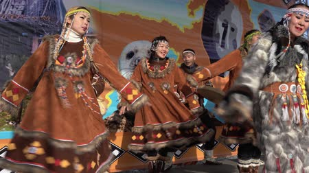 ethnography : KAMCHATKA PENINSULA, RUSSIA - NOV 4, 2018: Women and men in national clothing indigenous inhabitants Kamchatka dancing. Public concert, celebration of Koryak national holiday Hololo (Day of Seal).