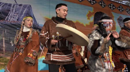 daleko : KAMCHATKA PENINSULA, RUSSIA - NOV 4, 2018: Women and men in national clothing indigenous inhabitants Kamchatka dancing. Public concert, celebration of Koryak national holiday Hololo (Day of Seal).