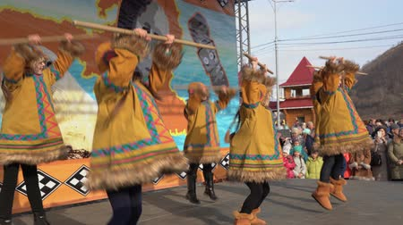 ethnography : KAMCHATKA PENINSULA, RUSSIA - NOV 4, 2018: Group of girls dancing in national clothing indigenous inhabitants Kamchatka. Concert, celebration of Koryak national ritual holiday Hololo (Day of Seal).