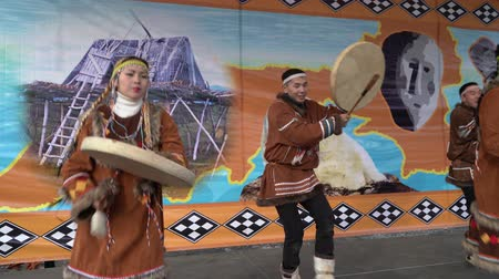domorodý : KAMCHATKA PENINSULA, RUSSIA - NOV 4, 2018: Women and men in national clothing indigenous inhabitants Kamchatka dancing with tambourine. Celebration of Koryak national holiday Hololo (Day of Seal).