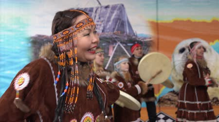 domorodý : KAMCHATKA PENINSULA, RUSSIA - NOV 4, 2018: Women in national clothing indigenous inhabitants Kamchatka dancing. Public concert, celebration of Koryak national ritual holiday Hololo (Day of Seal).