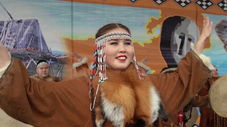 aborigine : KAMCHATKA PENINSULA, RUSSIA - NOV 4, 2018: Portrait of young woman dancer in national clothing indigenous Kamchatka decorated with red fox. Celebration of Koryak national holiday Hololo (Day of Seal). Stock Footage