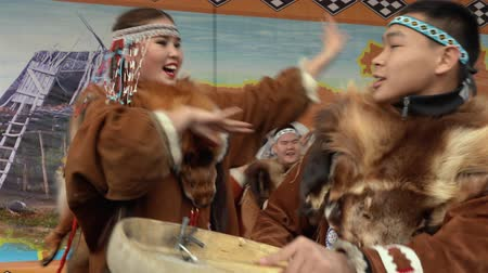 ethnography : KAMCHATKA PENINSULA, RUSSIA - NOV 4, 2018: Women and men in national clothing indigenous inhabitants Kamchatka dancing with tambourine. Celebration of Koryak national holiday Hololo (Day of Seal).