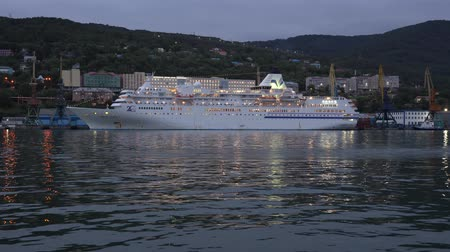 petropavlovsk : AVACHA BAY, KAMCHATKA PENINSULA, RUSSIAN FAR EAST - 4 SEPTEMBER, 2018: Evening view of white Japanese cruise liner Pacific Venus anchored at pier in Seaport Petropavlovsk-Kamchatsky City.