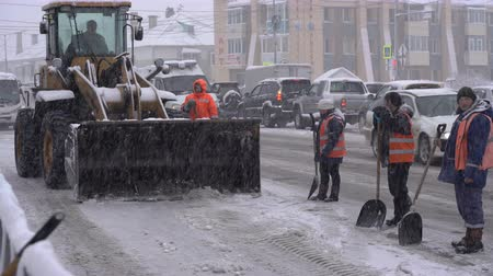 daleko : PETROPAVLOVSK KAMCHATSKY CITY, KAMCHATKA PENINSULA, RUSSIA - DECEMBER 26, 2018: Winter road maintenance - Blizzard.