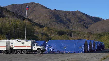 rescuer : KAMCHATKA PENINSULA, RUSSIA - OCT 3, 2018: Autumn view in mountains at army field tents town of Kamchatka Rescue Center Ministry of Civil Defence, Emergencies and Disaster Relief of Russian Federation Stock Footage