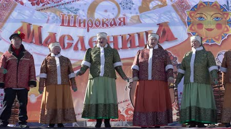 krep : YELIZOVO CITY, KAMCHATKA PENINSULA, RUSSIA - MARCH 10, 2019: Public concert Ensemble of Russian Folk Song Gorlitsa. Maslenitsa - religious, folk holiday, celebrated during last week before Great Lent.