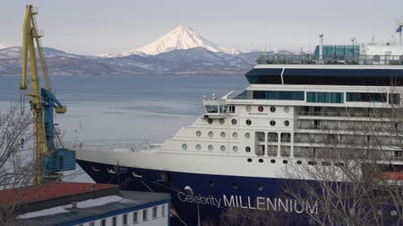 millennium : PACIFIC OCEAN, KAMCHATKA PENINSULA, RUSSIAN FAR EAST - 2 MAY, 2019: Passenger expedition Cruise Liner Celebrity Millennium anchored at pier in Commercial Sea Port Petropavlovsk-Kamchatsky City.