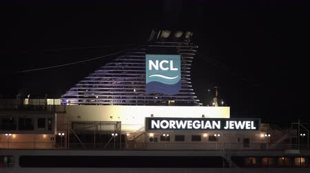upper peninsula : KAMCHATKA PENINSULA, RUSSIA - 2 MAY, 2019: Dark night view of upper deck of Cruise Liner Norwegian Jewel (NCL) with pipe spewing smoke. Empty deck of ship, while tourists and travelers sleep in cabins Stock Footage