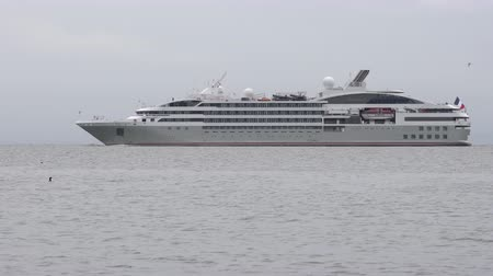 daleko : PACIFIC OCEAN, KAMCHATKA PENINSULA - 24 JUNE, 2019: View of white stately Expedition Passenger Cruise Liner Le Soleal (Compagnie du Ponant) sailing in Avacha Bay of Pacific Ocean in Russian Far East.