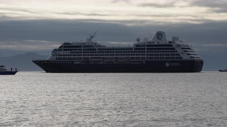 quest : KAMCHATKA PENINSULA, RUSSIAN FEDERATION - 15 AUG, 2019: Passenger Expedition Cruise Liner Azamara Quest sailing in Pacific Ocean on background of beautiful mountains coastline, cloudy sky in evening.