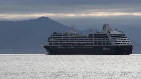quest : KAMCHATKA PENINSULA, RUSSIAN FEDERATION - 15 AUG, 2019: Expedition Passenger Cruise Liner Azamara Quest sailing in Pacific Ocean on background of beautiful mountains coastline, cloudy sky in evening.