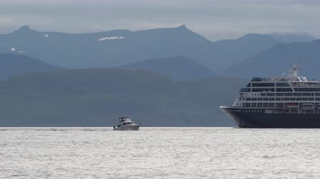 quest : KAMCHATKA PENINSULA, RUSSIAN FAR EAST - 15 AUGUST, 2019: Passenger Expedition Cruise Liner Azamara Quest sailing in Pacific Ocean on background of beautiful mountains coastline, evening cloudy sky.
