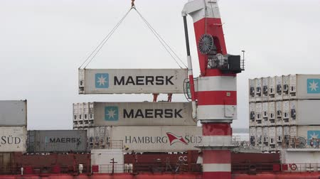 rakomány : Time lapse: crane unloads container ship Sevmorput - Russian nuclear-powered icebreaker lighter aboard ship carrier. Container terminal sea port. Pacific Ocean, Kamchatka, Russia - Aug 26, 2019