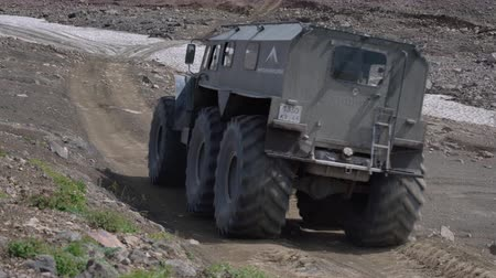 seis : Predator - snow and swamp extreme off-road, all-terrain vehicle for transporting tourists and travelers in most difficult, harsh conditions driving on mountain road. Kamchatka, Russia - Aug 16, 2019