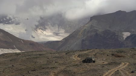 seis : Snow and swamp extreme off-road, all-terrain vehicle Predator transportation travelers and tourists in most difficult, harsh conditions - driving on volcanic road. Kamchatka, Russia - Aug 16, 2019