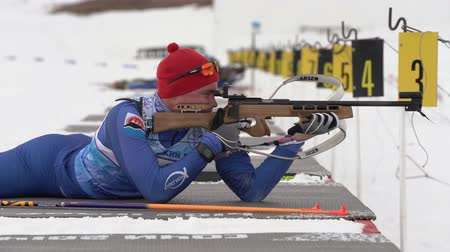 prone position : Sportsman biathlete rifle shooting in prone position. Biathlete Bulukov Leonid in shooting range. Open regional youth biathlon competitions East Cup. Kamchatka Peninsula, Russia - April 12, 2019. Stock Footage