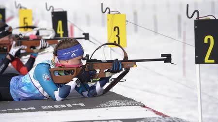 prone position : Sportswoman biathlete aiming rifle shooting in prone position. Biathlete Ekaterina Galitsyna Saint Petersburg in shooting range. Junior biathlon competitions East Cup. Kamchatka, Russia - Apr 13, 2019 Stock Footage