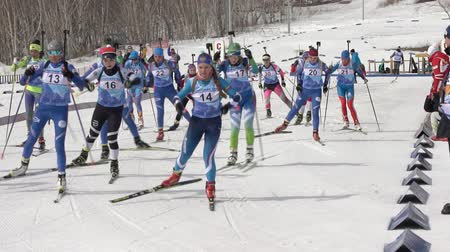 mass start : Group of sportswoman biathlete skiing on biathlon arena - mass start Regional junior biathlon competitions East of Cup. Petropavlovsk City, Kamchatka Peninsula, Russian Far East - April 13, 2019
