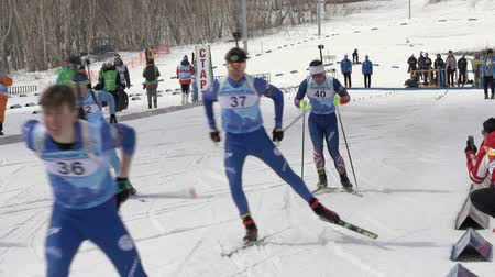 mass shooting : Mass start Regional junior biathlon competitions East of Cup - group of sportsman biathlete skiing on biathlon stadium. Petropavlovsk City, Kamchatka Peninsula, Russian Far East - April 13, 2019 Stock Footage