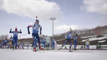 biathlon : Group of sportsman biathlete skiing on biathlon arena - mass start Regional junior biathlon competitions East of Cup. Petropavlovsk City, Kamchatka Peninsula, Russian Far East - April 13, 2019