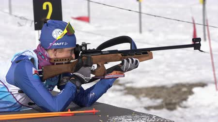 prone position : Sportswoman biathlete aiming, rifle shooting in prone position. Kamchatka biathlete Miroshnichenko Maria in shooting range. Junior biathlon competitions East of Cup. Kamchatka, Russia - April 13, 2019