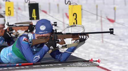 biathlon : Sportsman biathlete aiming, rifle shooting, reloading rifle in prone position. Biathlete Smolyakov Danila in shooting range. Junior biathlon competitions East of Cup. Kamchatka, Russia - Apr 14, 2019 Stock Footage