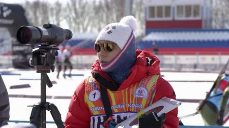 golyó : Coach of South Korea biathlon team instructs biathletes at shooting range of biathlon stadium during Junior biathlon competitions East of Cup. Kamchatka Peninsula, Russian Far East - April 14, 2019
