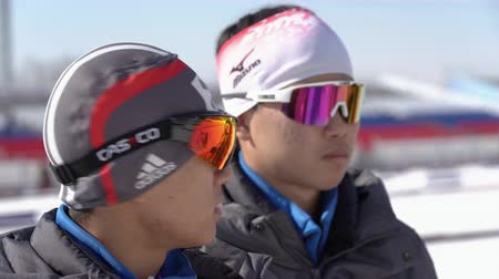 biathlete : Two biathletes of South Korea biathlon team during at shooting range stadium during Junior biathlon competitions East of Cup. Petropavlovsk City, Kamchatka Peninsula, Russian Far East - April 14, 2019
