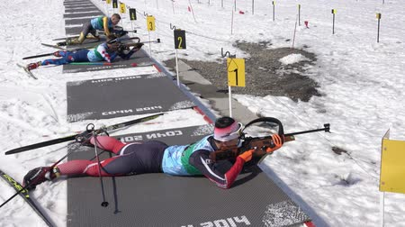 golyó : Korean sportsman biathlete Kim Minsu aiming, rifle shooting, reloads in prone position. South Korea biathlete in shooting range. Junior biathlon competitions East Cup. Kamchatka, Russia - Apr 14, 2019