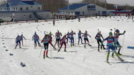 mass start : Group of sportswoman biathlete skiing on snow ski track biathlon stadium - mass start Junior biathlon competitions East of Cup. Petropavlovsk City, Kamchatka Peninsula, Russian Far East - Apr 13, 2019