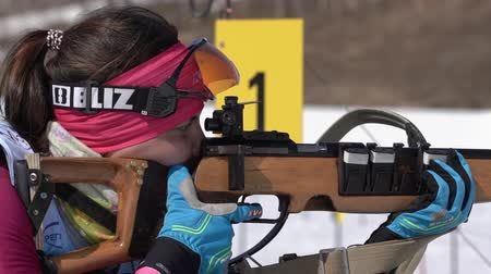 golyó : Sportswoman biathlete aiming, rifle shooting in prone position. Biathlete Ivchenko Anastasia in shooting range. Junior biathlon competitions East of Cup. Kamchatka Peninsula, Russia - April 14, 2019