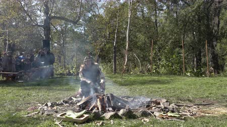 shaman : Itelmen shaman conducts ritual near bonfire in traditional clothing aboriginal during Itelmens national ritual festival of thanksgiving nature Alhalalalay. Kamchatka Peninsula, Russia - Sep 14, 2019