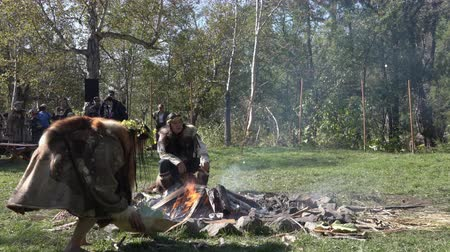 ethnographic : Itelmen shaman conducts ritual near bonfire in traditional clothing aboriginal during Itelmens national ritual festival of thanksgiving nature Alhalalalay. Kamchatka Peninsula, Russia - Sep 14, 2019