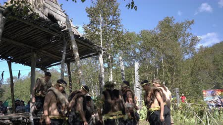 chaman : Itelmen people conducts ritual in traditional clothing aboriginal of Kamchatka during Itelmens national ritual festival of thanksgiving nature Alhalalalay. Kamchatka Peninsula, Russia - Sep 14, 2019 Archivo de Video