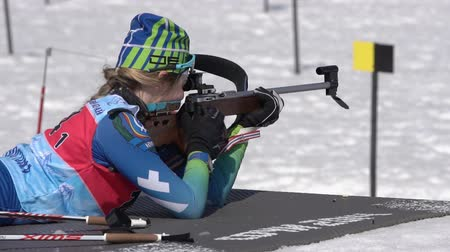 biathlon : Junior biathlon competitions East of Cup. Sportswoman biathlete aiming, rifle shooting, reloading standing position. Biathlete Legostaeva Anastasia in shooting range. Kamchatka, Russia - Apr 14, 2019.