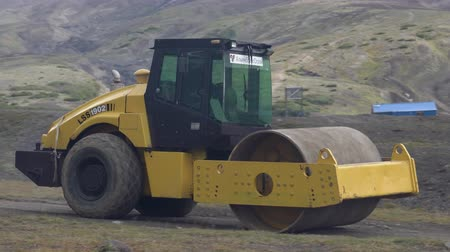 compactor : Luoyang LSS 1902 Chinese vibratory road machinery roller rides from roadworks, construction site on mountain country road. Avacha Volcano, Kamchatka Peninsula, Russian Far East - August 30, 2019.