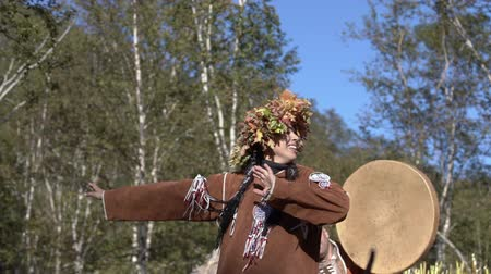 Young woman emotional dance in traditional clothing of indigenous people Kamchatka. Itelmens national ritual festival thanksgiving nature Alhalalalay. Kamchatka Peninsula, Russia - September 14, 2019 Стоковые видеозаписи