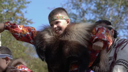 Boy dancing in traditional clothing of aboriginal people Kamchatka during Itelmens national ritual festival thanksgiving nature Alhalalalay. Kamchatka Peninsula, Russian Far East - Sep 14, 2019