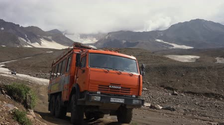 KamAZ - Russian off-road extreme expedition truck driving on mountain road in direction travel destinations for mountain climbing, hiking: active Mutnovsky Volcano. Kamchatka, Russia - August 16, 2019