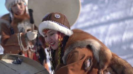 kutya : Indigenous female expression dancing with tambourine in national winter clothing native people. Kamchatka traditional Sled Dog Race Championship Beringia. Kamchatka Peninsula, Russia - Feb 22, 2020.