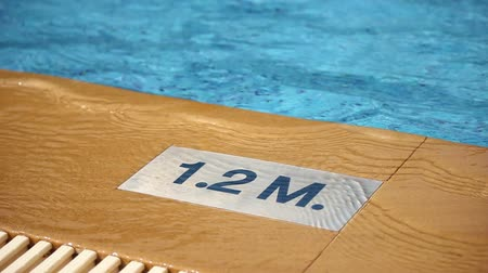 1.2 M. Depth marking on pool edge.inscription of the swimming pool depth.pool depth sign Wideo