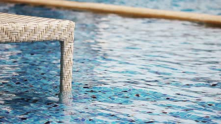 Beach Chair in Swimming pool.summer day in Thailand.